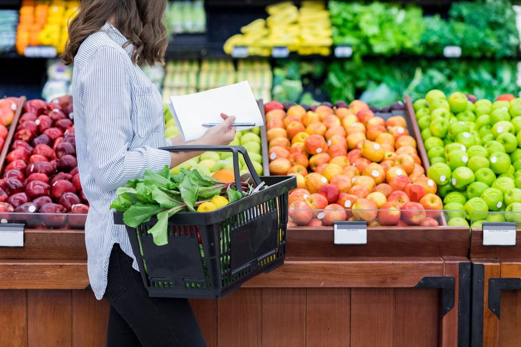 woman shopping for produce in a grocery store
