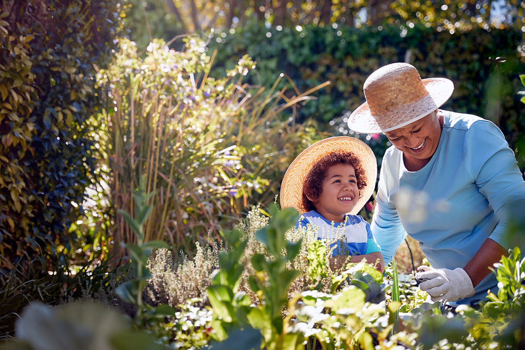 grandma and child gardening outdoors - spring allergy relief