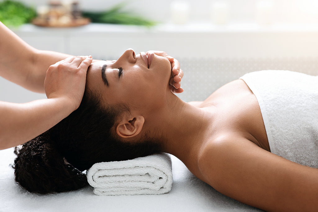 woman getting acupressure treatment for spring seasonal allergy relief