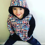 children's mixed tape pattern hoodie jumper with pockets on model