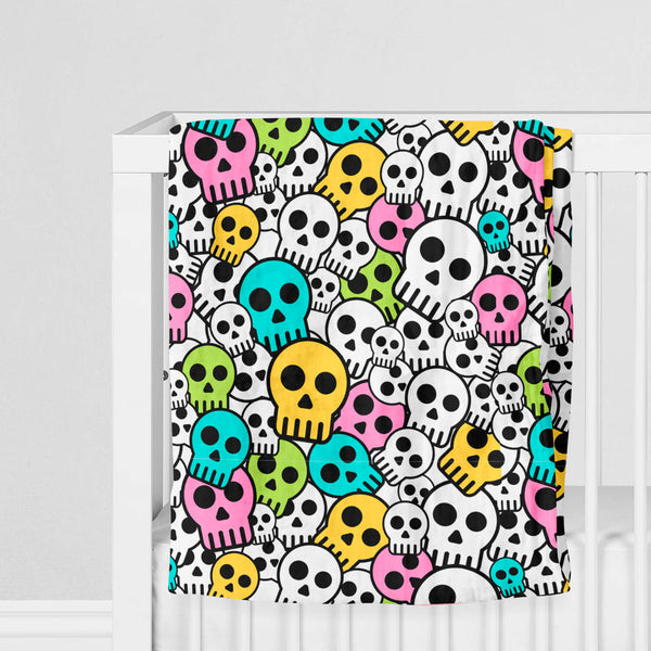 100% Muslin Cotton Swaddle Blanket with Skulls on crib