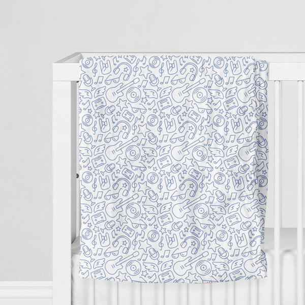 100% Muslin Cotton Swaddle Blanket with Rock 'N' Roll pattern on crib