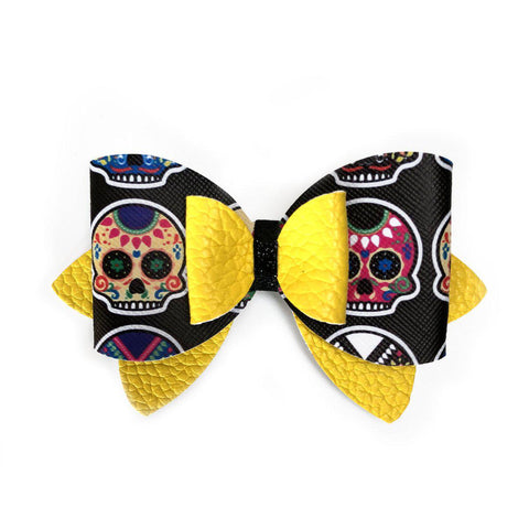 Girls hair bow with skulls yellow