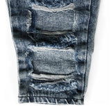Kids ripped distressed jeans closeup