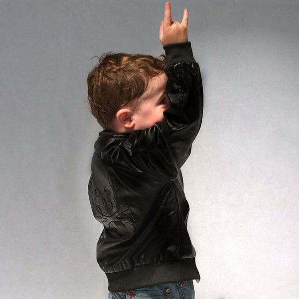 Kids black faux leather Jacket with skull design on model