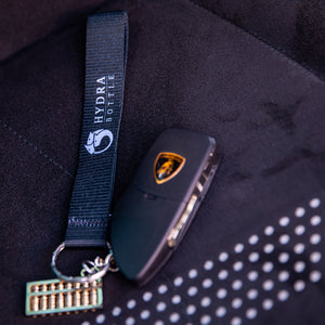 Hydra Bottle Landyard next to Lamborghini keys
