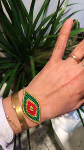 Green and red eye bracelet