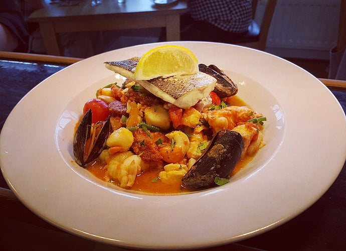 Mediterranean fish stew on the menu at Filbeys Bistro featuring Manx Chorizo from Close Leece Farm .