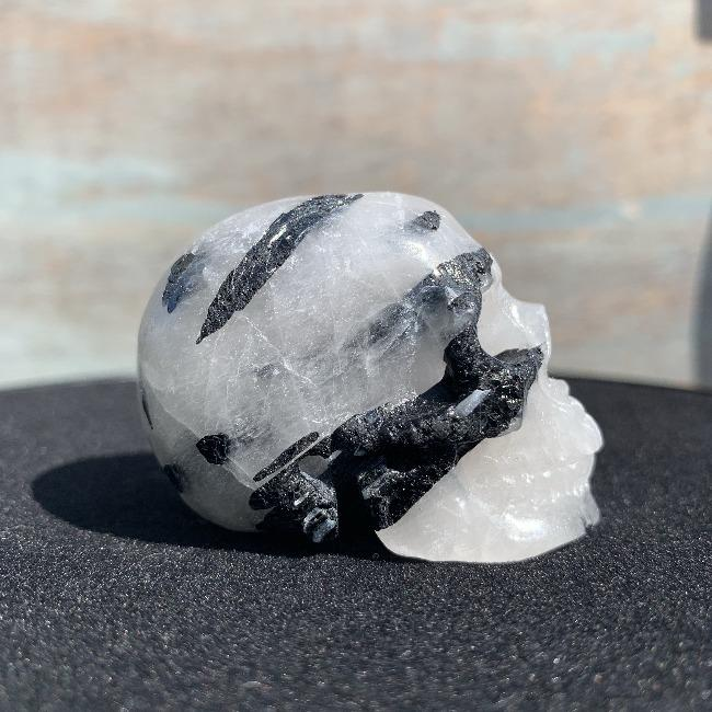 healing crystal black tourmilated quartz carved skull front view