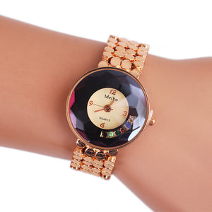 Women's Fashion Alloy Pointer Quartz Wrist Watch. Band is Gold Colored & Nicely Textured.