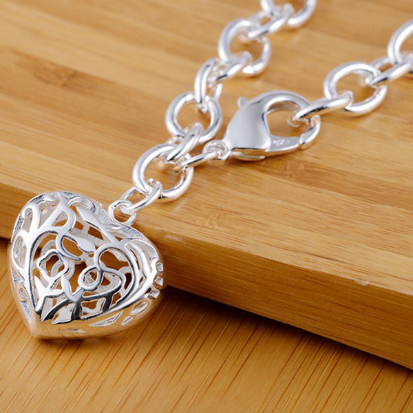 """The Traditional Heart Charm Bracelet."" 925 Sterling Silver Filigree Heart. Offered by Elite Web Store."