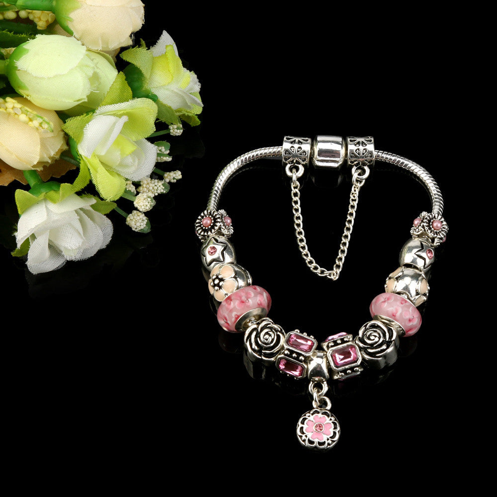 """The Lovely Multi-Charmed Silver Bracelet."" 3 Colored Bead Options. Offered by Elite Web Store."