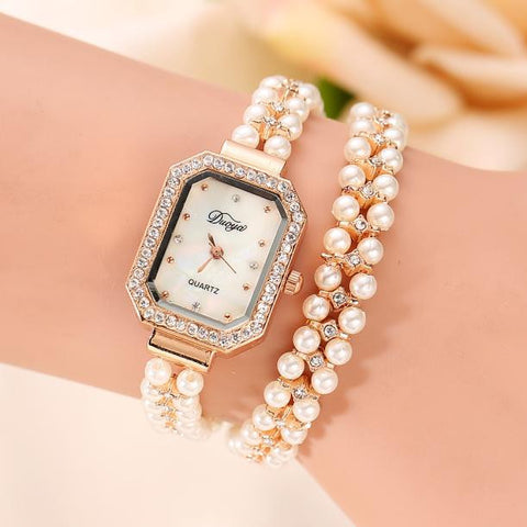 """The Synthetic Pearl Watch Bracelet."" Various Colors & Face Styles. Offered by Elite Web Store."