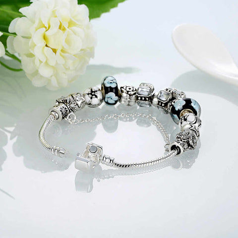 """Multi-Charmed Bracelet."" GORGEOUS. Available in Red or White Colors. Offered by Elite Web Store."