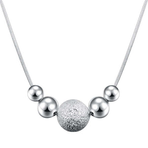 Chic, Circular Charm Pendant Silver Necklace - with 5 Circles at the Base of the Necklace.