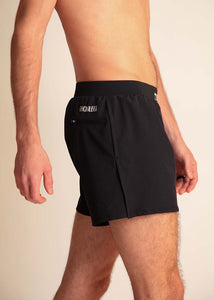 "chicknlegs black men's 4"" half split running shorts side view showing the split."