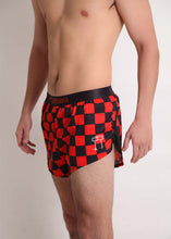 "ChicknLegs men's red and black checkerboard 2"" split running shorts side view gives a peek at our logo and mesh paneling."