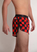 "ChicknLegs men's red and black checkerboard 2"" split running shorts side view showcasing our mesh paneling on the side splits."