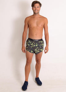"ChicknLegs mens green camo 2"" split running shorts fully body view."