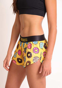 "ChicknLegs women's donuts 1.5"" split running shorts side view with logo."