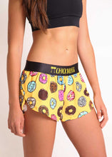 "ChicknLegs women's donuts 1.5"" split running shorts side view."
