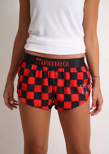 "ChicknLegs women's checkerboard 1.5"" split running shorts front view."