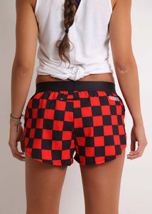 "ChicknLegs women's checkerboard 1.5"" split running shorts rear view showcasing our zipper pocket to stash the essentials."