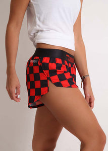 "ChicknLegs women's checkerboard 1.5"" split running shorts side view."