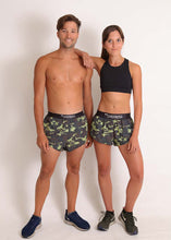 ChicknLegs matching men's and women's green camo split running shorts.