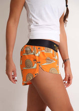 "ChicknLegs women's snail's pace 1.5"" split running shorts side view showcasing the side split with white tank top."