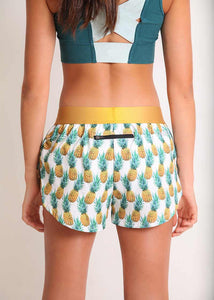 "ChicknLegs women's trippy pineapples 1.5"" split running shorts rear view."