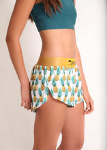 "ChicknLegs women's trippy pineapples 1.5"" split running shorts side view."