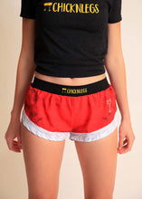 "chicknlegs santa shorts women's 1.5"" split running shorts front view."