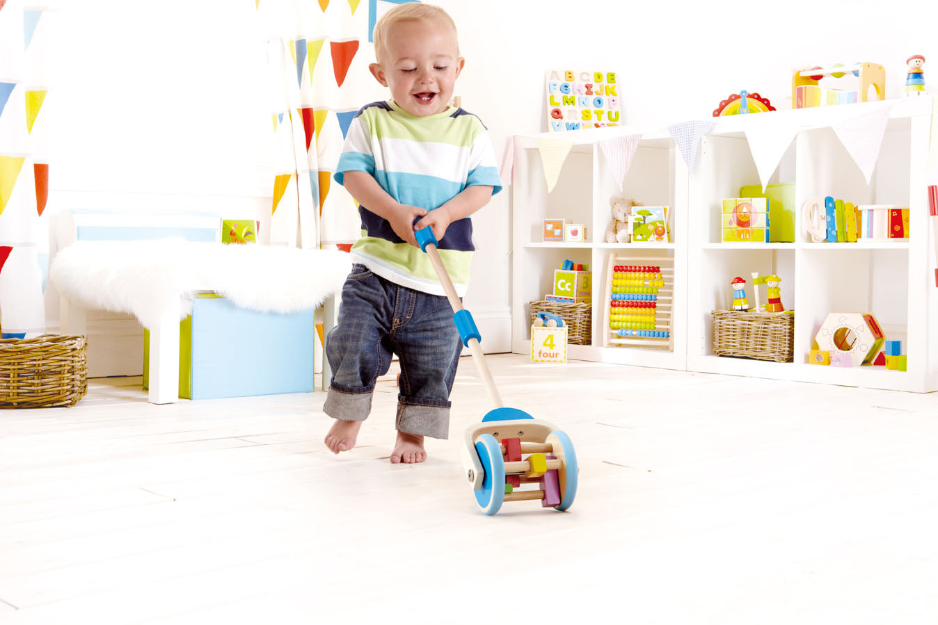 Hape Push & Pull Lawn Mower Toy - WoodenToys.com
