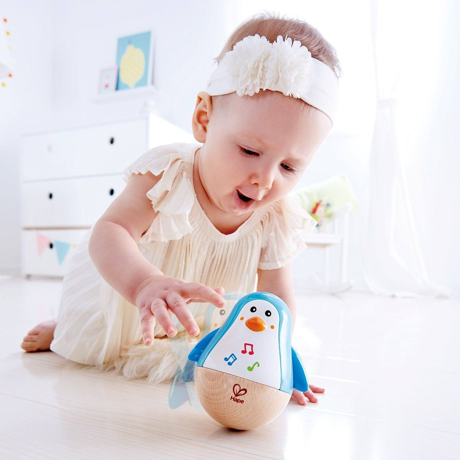 Hape Wobbling Melody Penguin - WoodenToys.com
