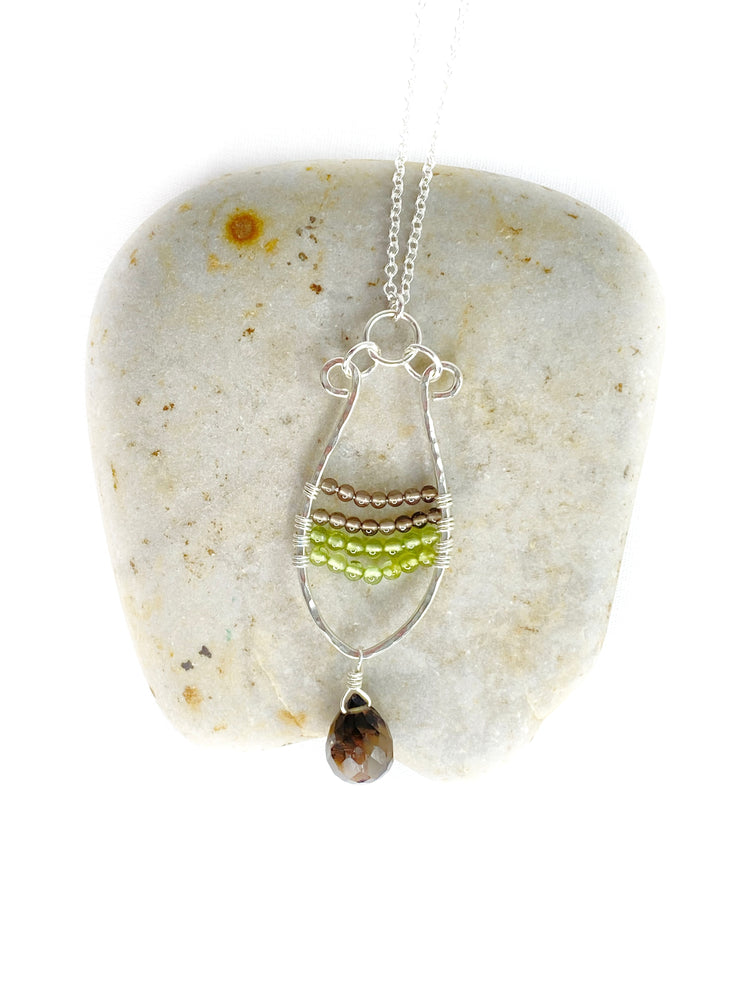 Handmade sterling silver, Peridot and Smoky Quartz wire wrapped long necklace.