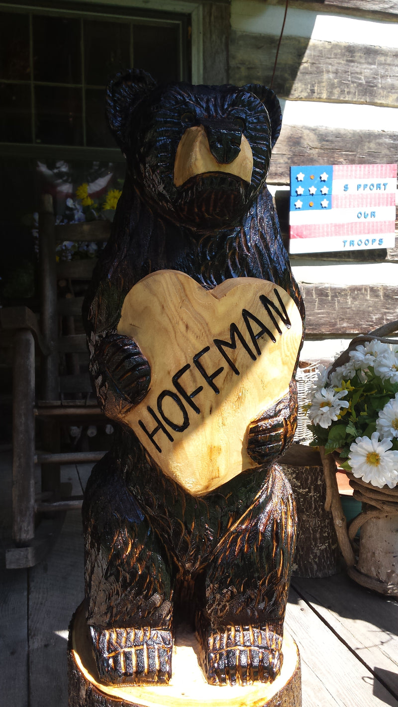 Chainsaw Carved Bear with a heart