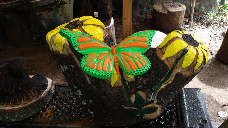 Chainsaw and Hand carved butterfly