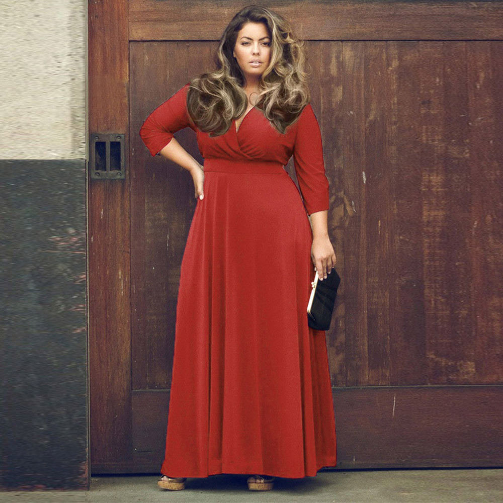 a person wearing a red dress talking on a cell phone