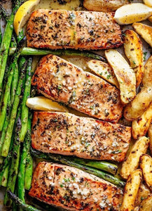 Dinner for two: Grilled Salmon includes asparagus, roasted fingerling potatoes and a sourdough baguette.