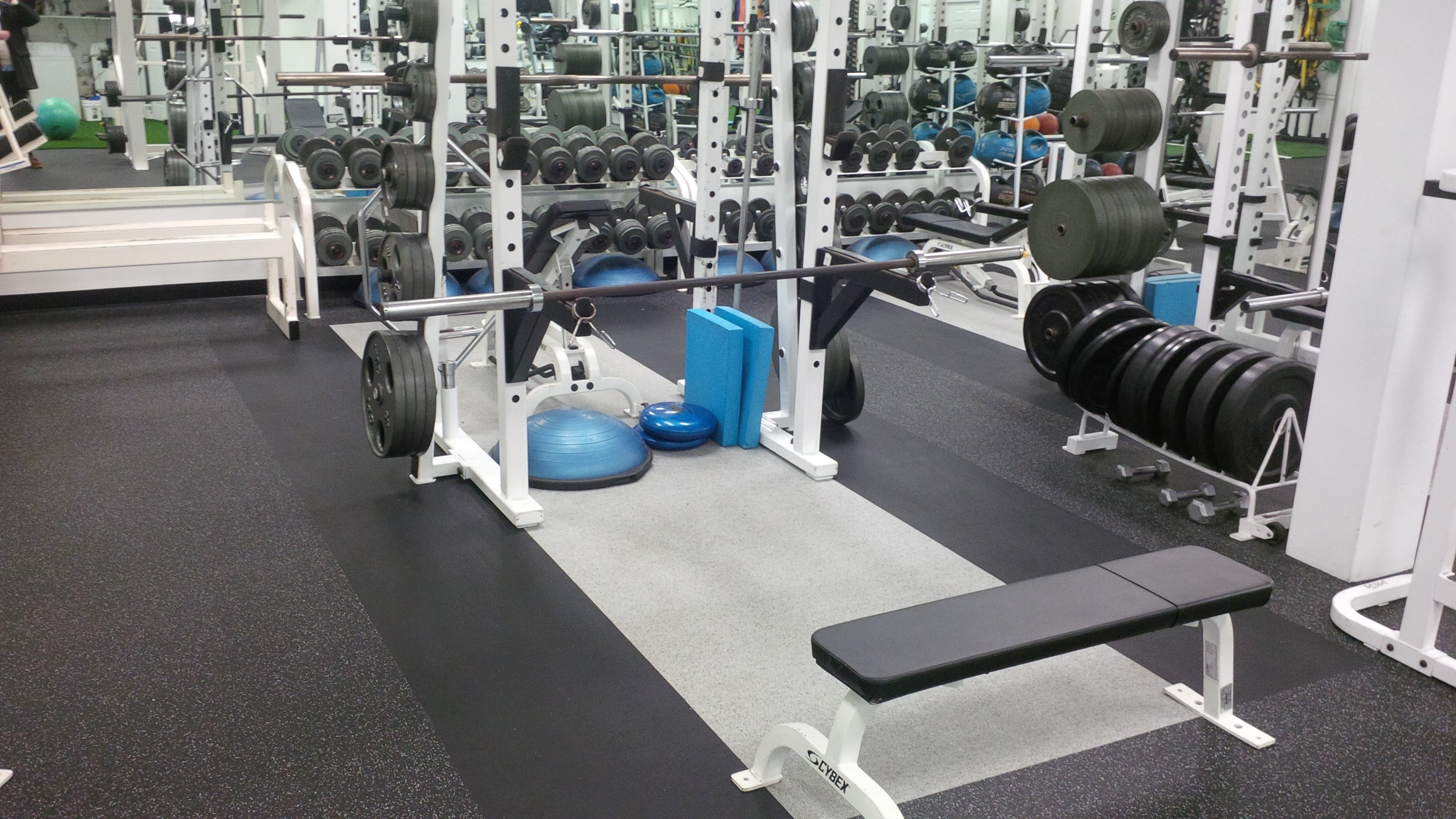 Rubber flooring in a small weightlifting gym.