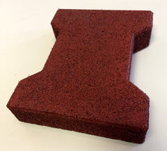 A sample of the original-size Regupol interlocking rubber pavers in red.