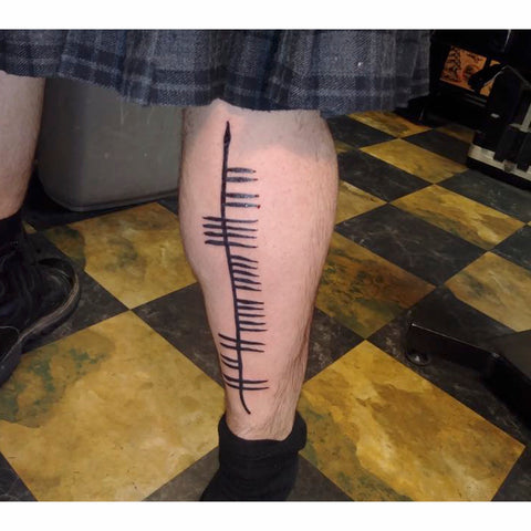 Ogham tattoo leg