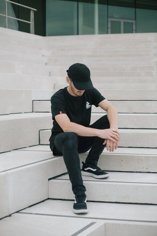 Black T Shirt Breach Parrkour Free Running Athlete Sitting Down