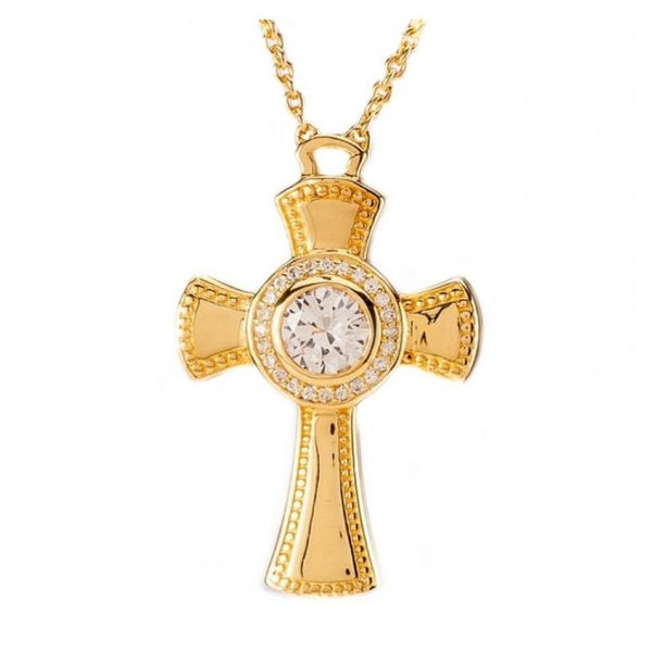 A 14 Karat gold plated templar cross with a white sapphire center. The golden cross has a circular center and features a design similar to the templar cross. This cross features the word