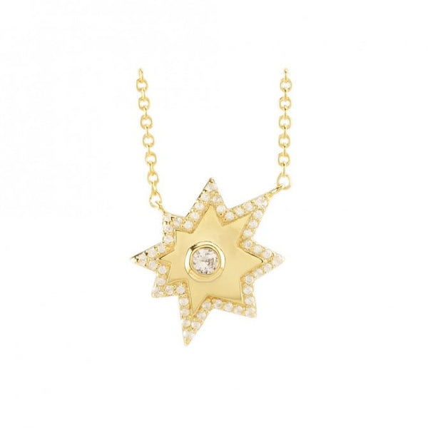 This Image shows a 14 Karat gold plated asymmetrical 8 point star. At the center of this star is a large white sapphire and this beautiful pendant is on an extendable chain which goes all the way to 22