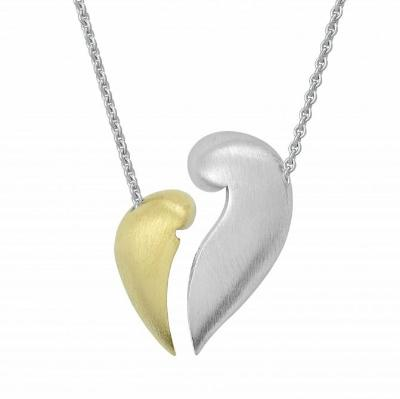 This image shows the  mother and child pendant, the child portion of the pendant is 14 Karat gold plated. When the mother and child connect they form a stunning heart like shape, the back is engraved with