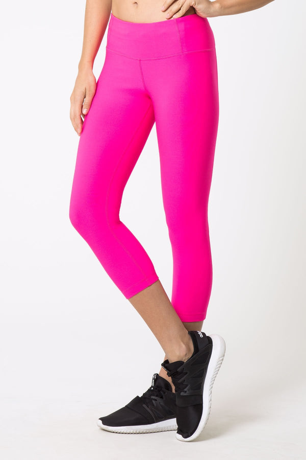 MPG Sport's clearance warehouse women's Dare Signature Capri in Pink Glo
