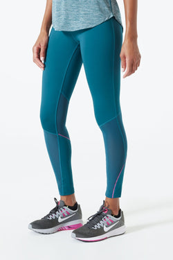 MPG Sport's clearance warehouse women's Lateral 7/8 Run Legging in Jade Green