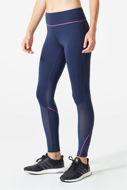 MPG Sport's clearance warehouse women's Lateral 7/8 Run Legging in Navy Sky Blue